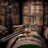 Glencairn glass of whiskey on a cask